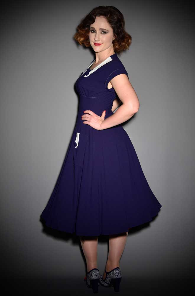 The Doris Dress is a darling navy and white dress with a striking late 40's, early 50's silhouette by House of Foxy at DeadlyistheFemale.com