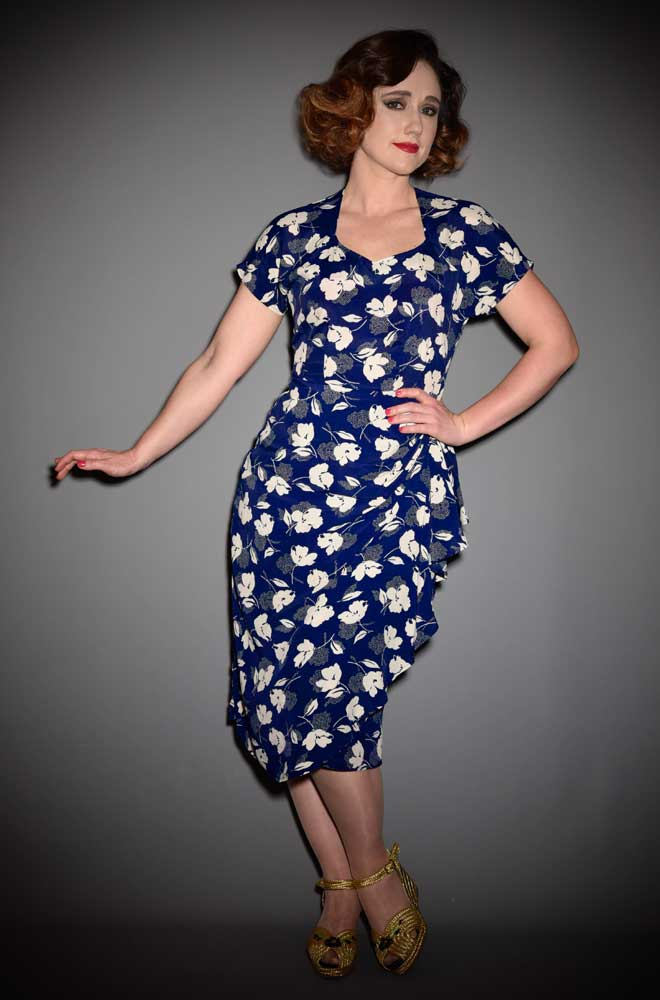 The Hayworth Dress is a stunning 1940's inspired dress in a beautiful navy Deco Floral print by House of Foxy at DeadlyistheFemale.com