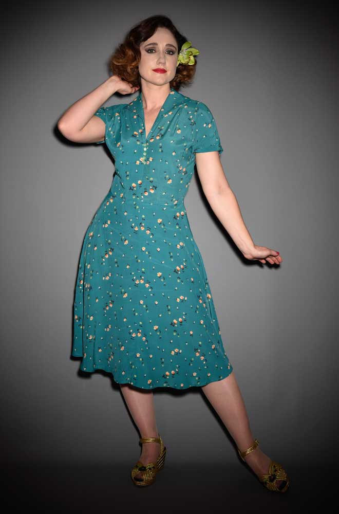 Effortless 1940's style with the Peggy Sue Dress. This fresh floral dress has a pretty ditzy floral print that is perfect for spring and summer!
