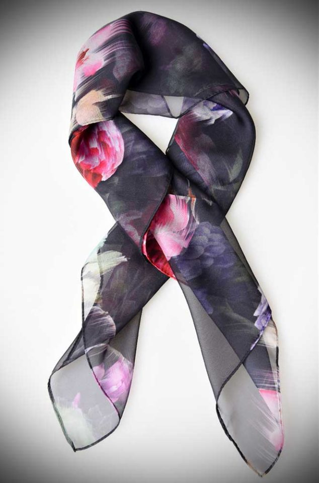 Instant pinup style with this black and dashing floral printed hair scarf! A silky vintage inspired chiffon scarf perfect for tying up and around your divine 'do. Any excuse for a little sky-high hair help!