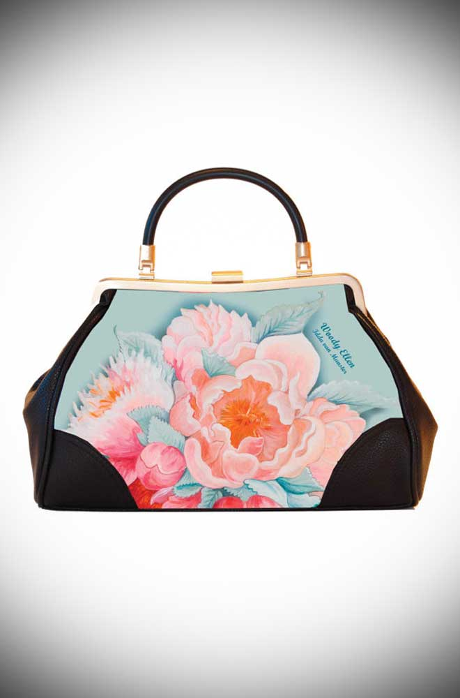 Woody Ellen's Idda van Munster collection Handbag features pink roses and butterflies on a soft blue. Available now at UK stockists Deadly is the Female.