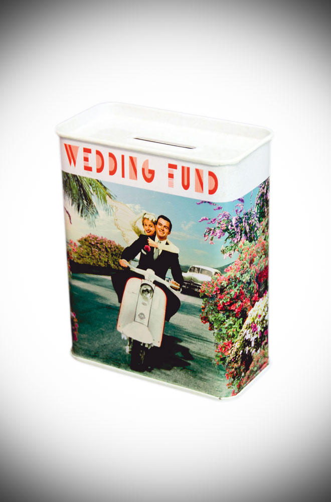 Pop your pennies inside this wedding money box. Made from tin, this money box features happy newly weds, riding their scooter off into the sunset!