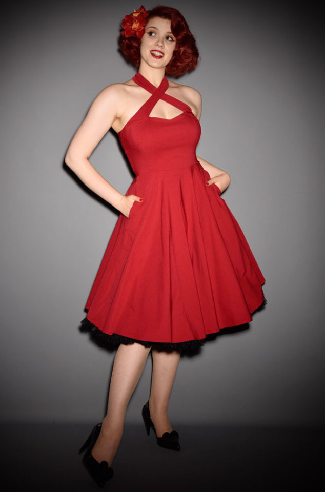 The red Rita Swing Dress is a 1950s pinup inspired dress with our favourite detail - pockets. Unique Vintage at Deadly is the Female.