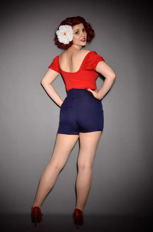 These navy blue high waisted sailor shorts are a pinup dream! With white buttons & anchor details. Deadly is the Female are UK stockists of Unique Vintage.