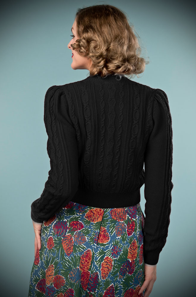 This stunning black 40's Ice Skater Cardigan by Emmy Design is a beautiful wardrobe essential available at UK stockists DeadlyistheFemale.com