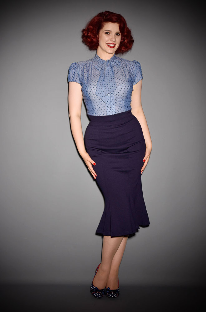 The navy Diva pencil skirt is a stylish flared skirt designed to highlight the wiggle in your walk. Heart of Haute at UK stockists, Deadly is the Female.