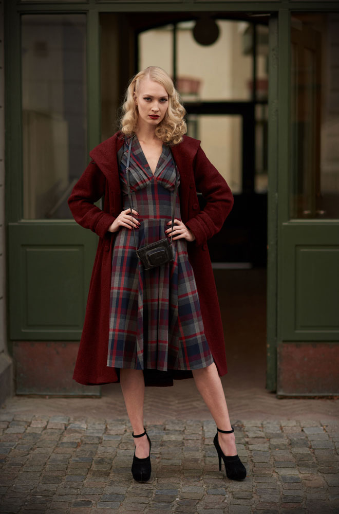 The wine tartan Valeria-Bo swing dress is perfect for an effortless daytime look. By Miss Candyfloss at UK stockists, Deadly is the Female.