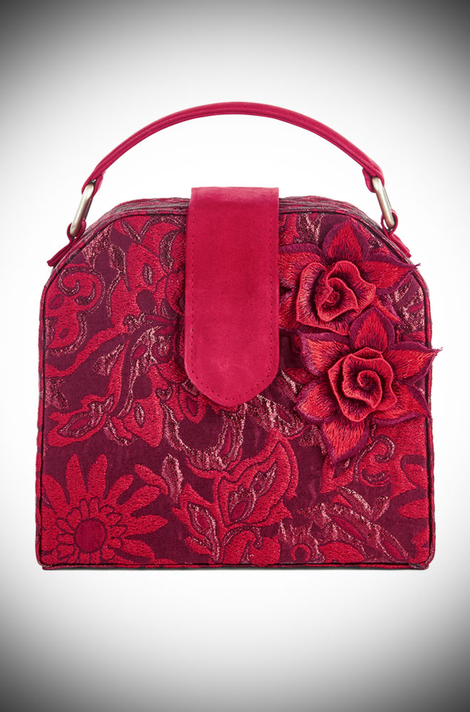 The Quebec Bag is a chic red box bag by Ruby Shoo. It is a striking brocade bag that is sure to turn heads. Available now at DeadlyistheFemale.com