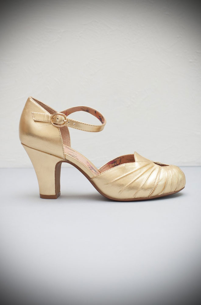 The Miss L Fire Gold Amber shoes are beautiful vintage inspired heels. Made in stunning metallic leather these fantastic 40s shoes have are just charming.