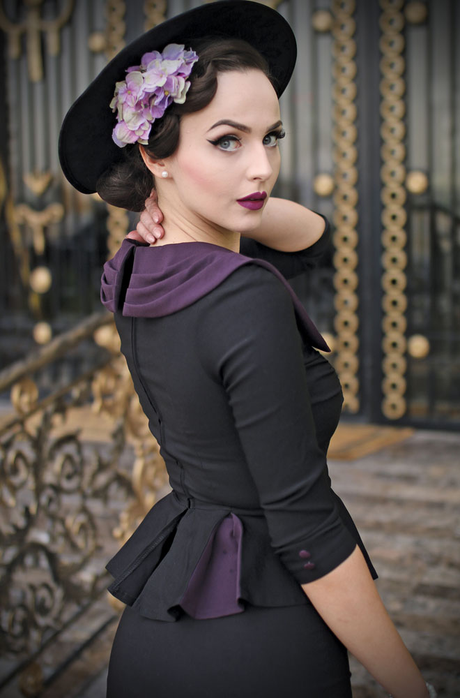 The Stop Staring Elisha Dress is a striking vintage inspired dress. Disguised as a jacket and skirt, this 1930's style dress is effortlessly chic.