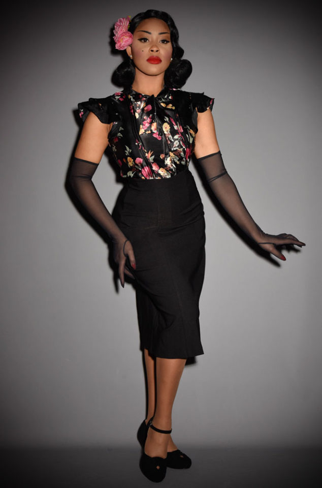 The Stop Staring Flourish Dress is a vintage inspired dress. Disguised as a fabulous floral blouse & classic black skirt, this dress is oh so chic.