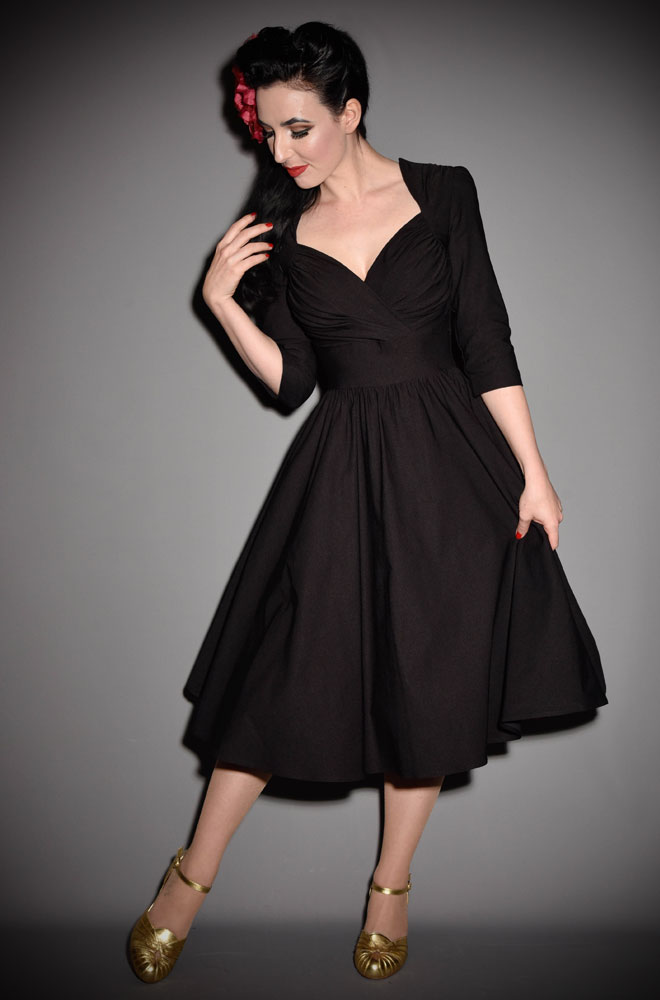 The Stop Staring Loma Dress is a timeless swing dress designed to sculpt your curves into a sassy hourglass. This chic LBD is a wardrobe essential.