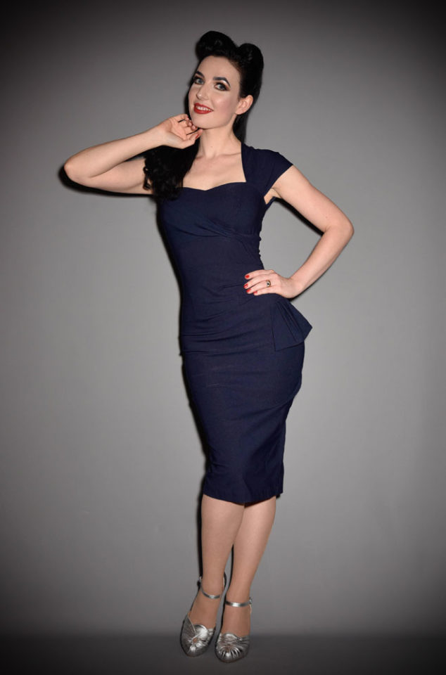 Stop Staring Navy Uma Dress at official UK stockists, Deadly is the Female. A classy but sassy dress that is sure to put a wiggle in your walk!