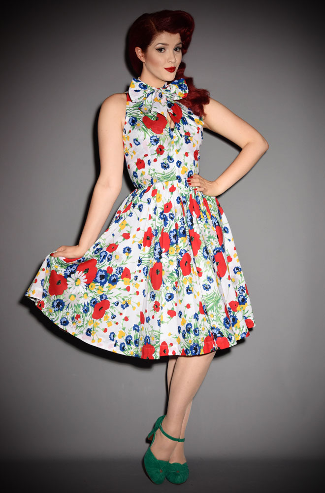 The Trashy Diva Streetcar dress is a vintage 50's inspired swing dress in 60's Wildflowers print. Deadly is the Female are UK stockists of Trashy Diva.