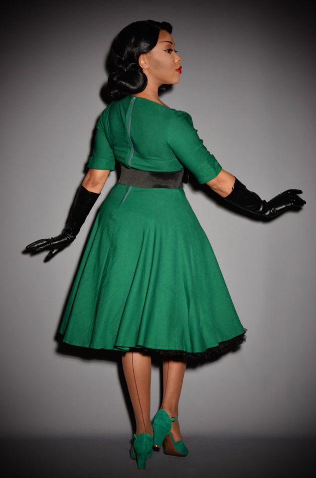 The Delores is a darling 1950's inspired emerald green swing dress by Unique Vintage at UK stockists, Deadly is the Female.