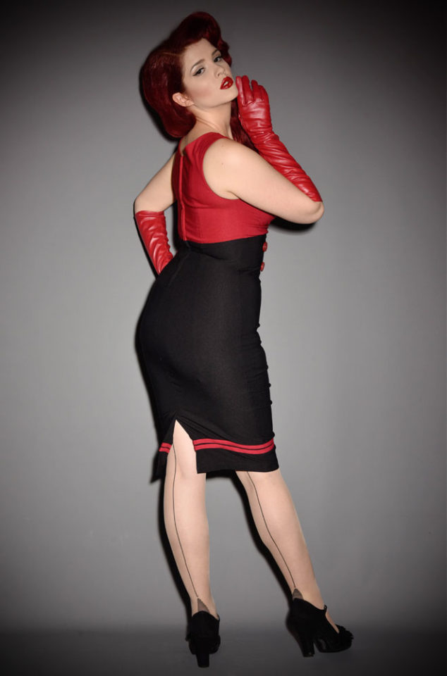 The nautical styling and a curve boosting cut set the Set Sail Diva Dress apart from the rest! This retro sailor wiggle dress in red & black is a knockout.