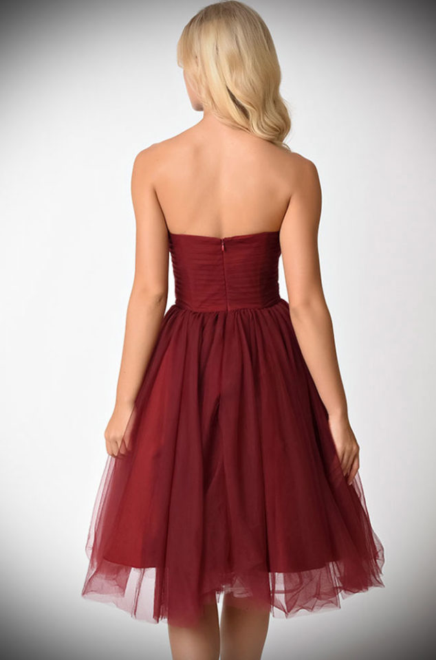 The Warner dress is a stunning vintage reproduction cocktail dress in burgundy. This romantic dress is rich in midcentury vintage appeal. By Unique Vintage.