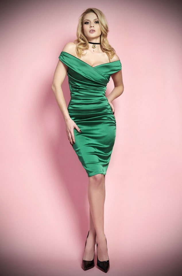 The Wheels & Dollbaby Mantrap Dress is guaranteed to stop traffic! This emerald green wiggle dress is perfect for pinups & lovers of classic vintage style.