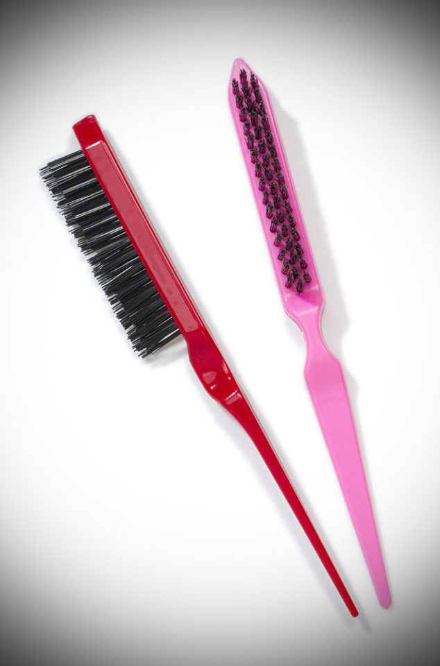 A colourful Teasing and Smoothing Brush for the perfect up-do and maximum volume! Available now in red or pink at DeadlyistheFemale.com