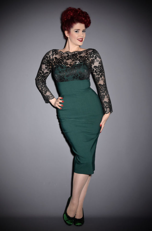 A timeless classic, the Emerald Bardot dress is a striking wiggle dress with luxurious lace details. Perfect for party season.