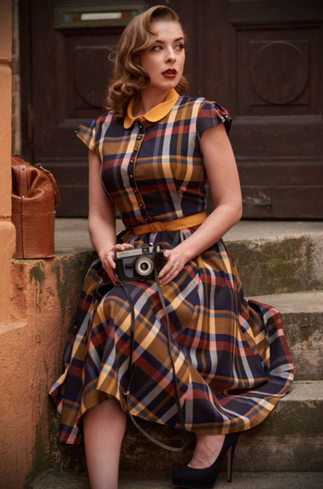 The Ulrika Tartan Dress is a gorgeous shirt dress in a navy and mustard check by Miss Candyfloss at UK stockists, Deadly is the Female.