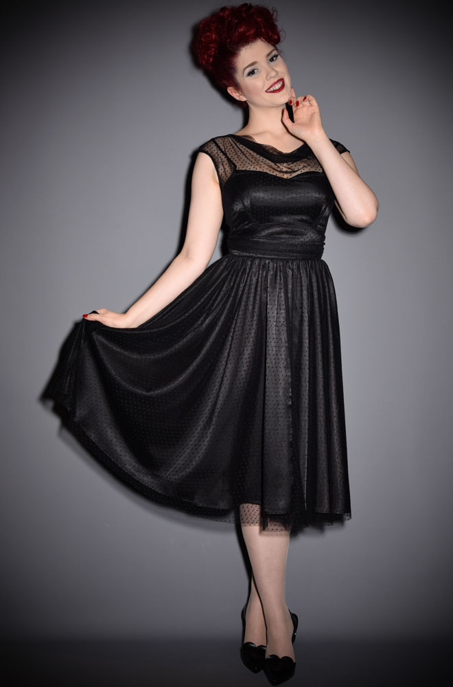 The Stop Staring Adriel dress is a lesson in understated elegance. This chic 1950's style Little Black Dress is a wardrobe essential.