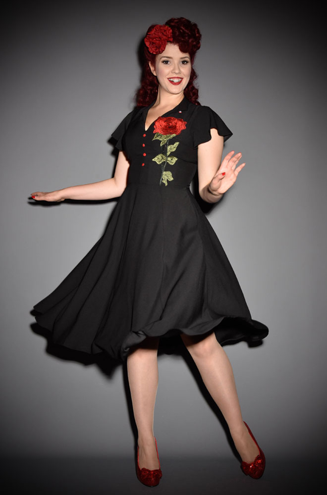The Baltimore Rose Dress is a striking swing dress rich in 1950s vintage appeal by Unique Vintage at UK stockists, Deadly is the Female. This dress is a show stopper! The oversizes rose corsage detail is sure to turn heads where ever you go! Perfect for pinups and retro style lovers.