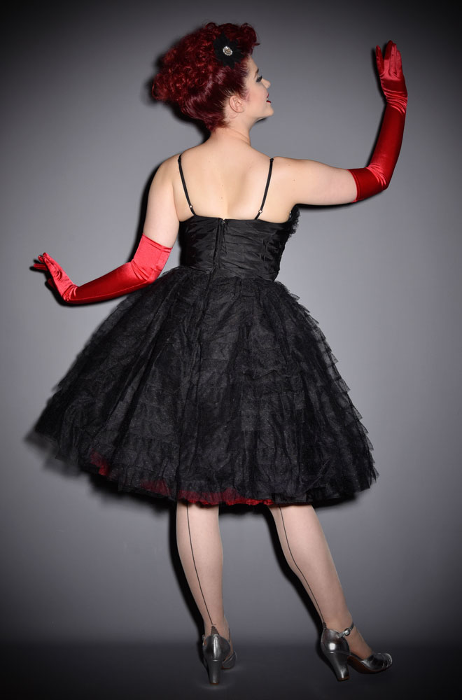 The Sweetheart Cupcake dress is a stunning vintage reproduction cocktail dress. This little black dress is rich in 1950s vintage appeal. By Unique Vintage.