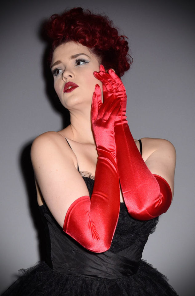 Opera-length red satin evening gloves by What Katie Did. They work with fashions from almost any time period, having been popular for over 300 years.
