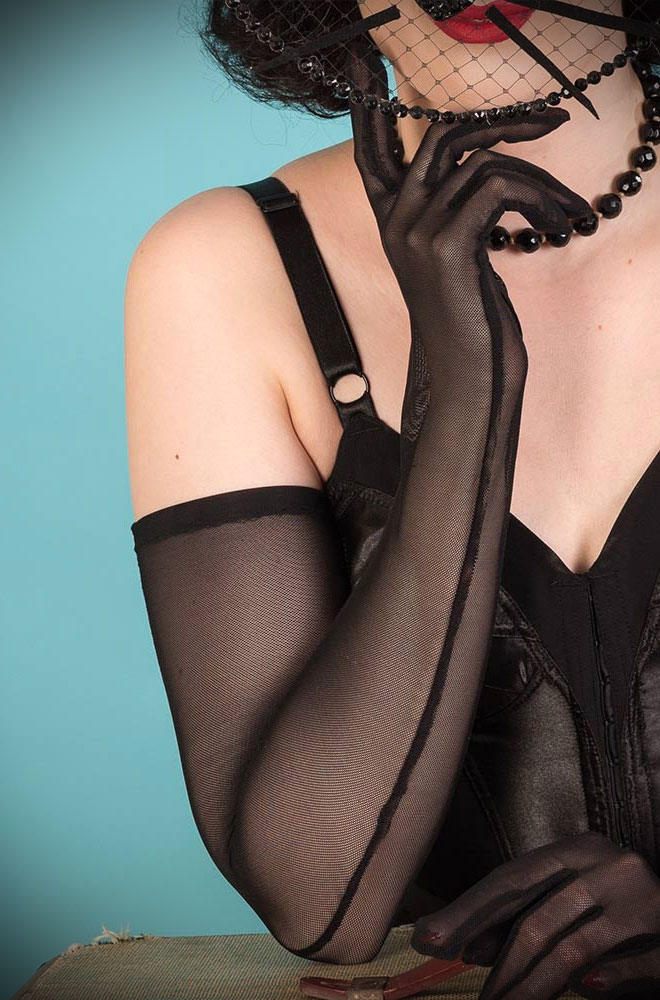 Opera-length Sheer Black Evening Gloves by What Katie Did. They work with fashions from almost any time period, having been popular for over 300 years.