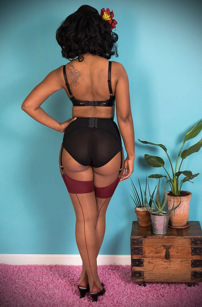 The Nutmeg Claret Seamed stockings are elegant nylons with a deep red wine seam. They add a little bit of glamour to any outfit.
