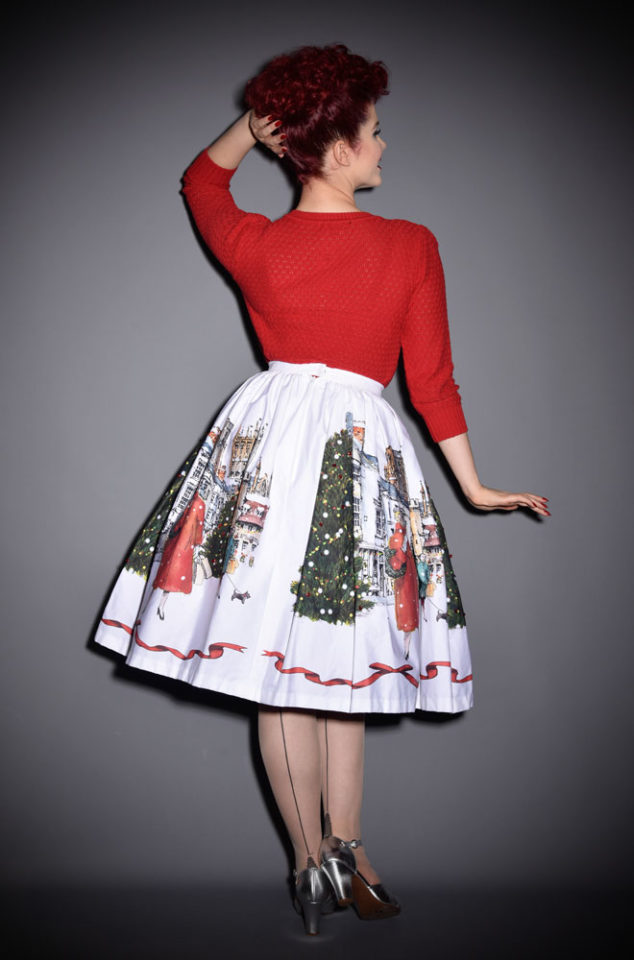 Christmas Souvenir Skirt featuring an illustration of Wells Cathedral. It is hand finished with meticulous attention to detail & embellished with sequins