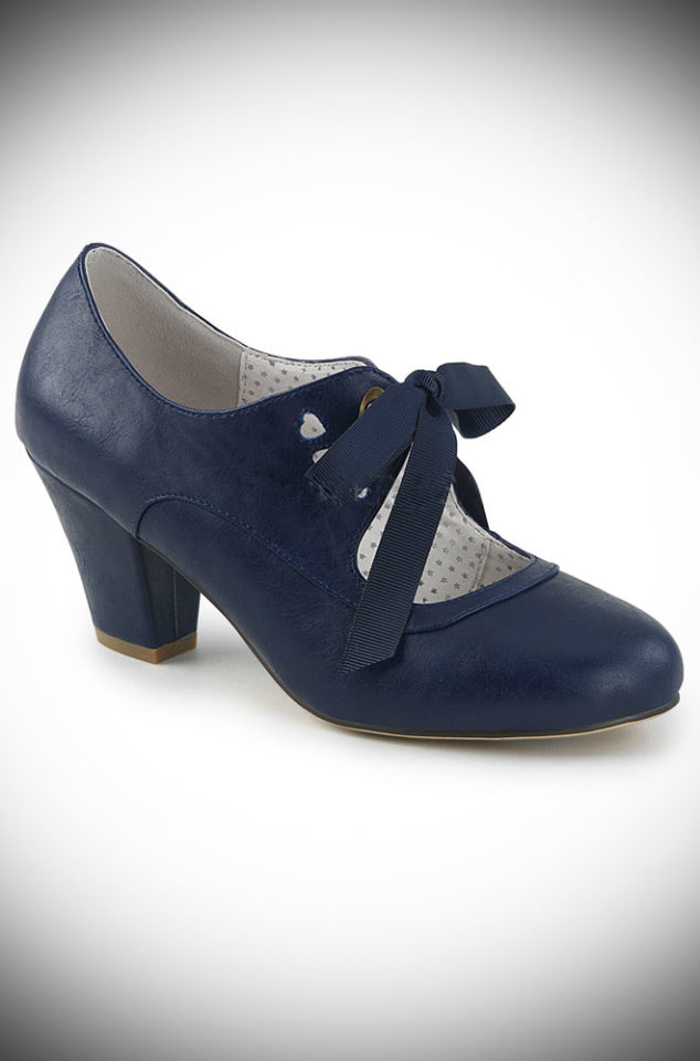 These Navy Mary Jane Shoes by Pinup Couture are classic and chic. We adore the vintage details, low cuban heel and ribbon tie.