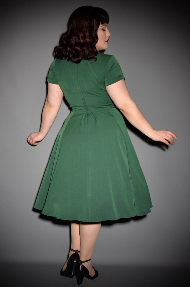 An elegant greenvintage style swing dress, theEmerald Elena Dress is the perfect way to add some vintage glamour to your daytime wardrobe. By Miss Candyfloss at UK stockists, Deadly is the Female.