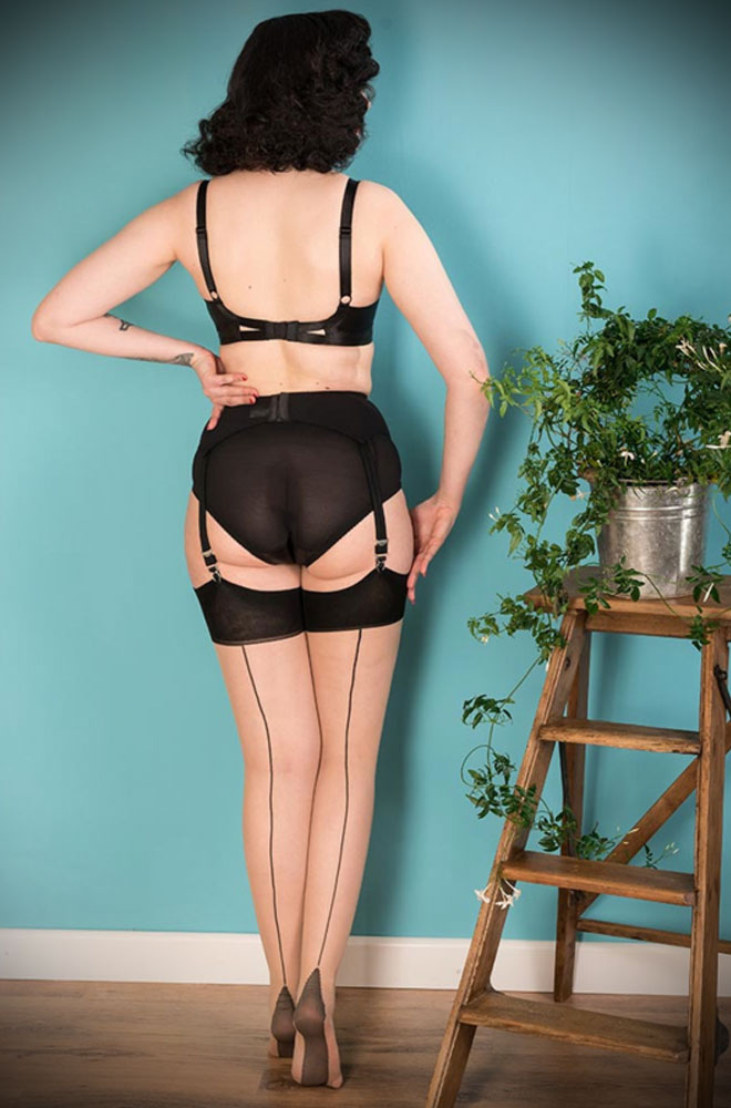 The Contrast Black Glamour Seamed Stockings are sheer champagne nylons with a classic black seam. They add a little bit of glamour to any outfit.
