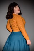 Brand new for Spring/Summer! The stunning Mustard Peggy Sue Cardigan by Emmy Design is a beautiful wardrobe essential. The striking mustard colour is warm and flattering to all skin tones, as well as being an authentic 1940's hue. Deadly is the Female are UK Stockists of Emmy Design.