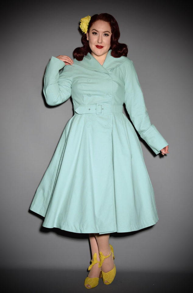 The mint Antonella Swing Coat is a stunning 1950's trench coat transformed into a fresh spring coat with satin lining by Miss Candyfloss. This chic style coat is vintage style at it's best. The mint colour is a fresh spin on this classic coat! Available now at DeadlyistheFemale.com