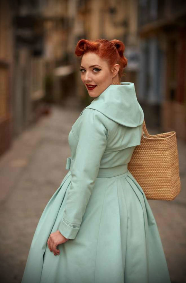 The mint Antonella Swing Coat is a stunning 1950's trench coat transformed into a fresh spring coat with satin lining by Miss Candyfloss. This chic style coat is vintage style at it's best. The mint colour is a fresh spin on this classic coat! Available now at DeadlyistheFemale.comv