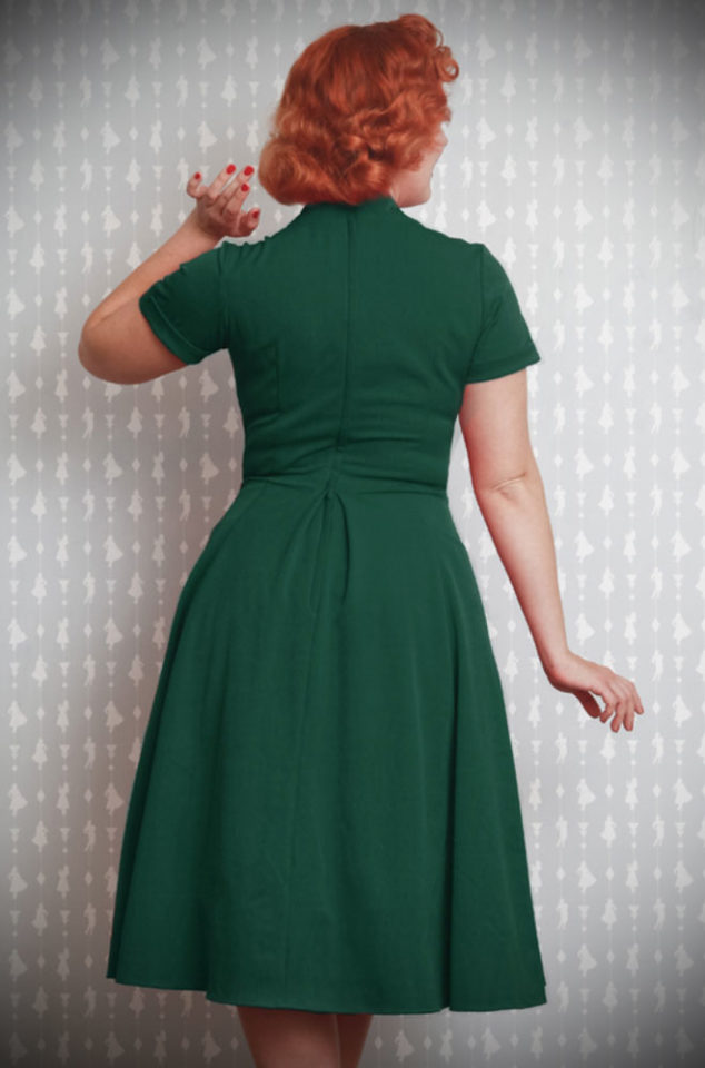An elegant green vintage style swing dress, the Emerald Elena Dress is the perfect way to add some vintage glamour to your daytime wardrobe. By Miss Candyfloss at UK stockists, Deadly is the Female.
