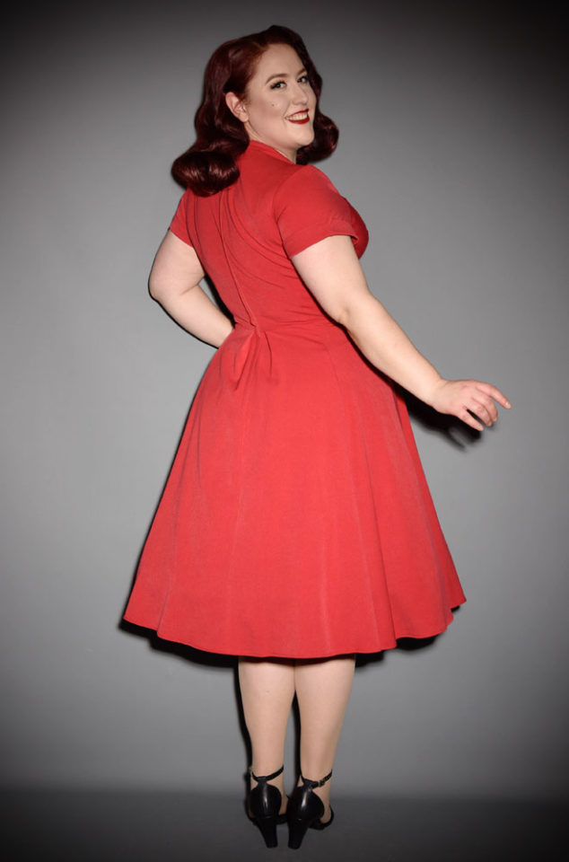 An elegant lipstick red vintage style swing dress, the Red Elena Dress is the perfect way to add some vintage glamour to your daytime wardrobe. By Miss Candyfloss at UK stockists, Deadly is the Female.