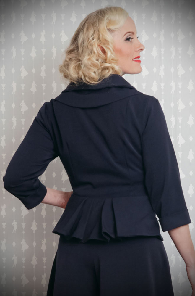 The Navy Noa-Lee 1940s Blazer is a stunning vintage inspired jacket. This timeless blazer will become an instant wardrobe essential. DeadlyistheFemale.com are proud UK stockists of Miss Candyfloss