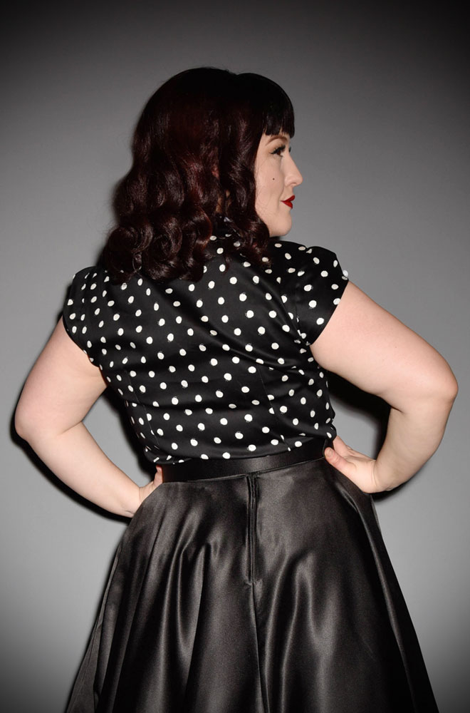 The Black Polka Salome Blouse is a sweet and effortless dotty blouse with a white scallop collar. www.DeadlyistheFemale.com are proud UK stockists of Miss Candyfloss.