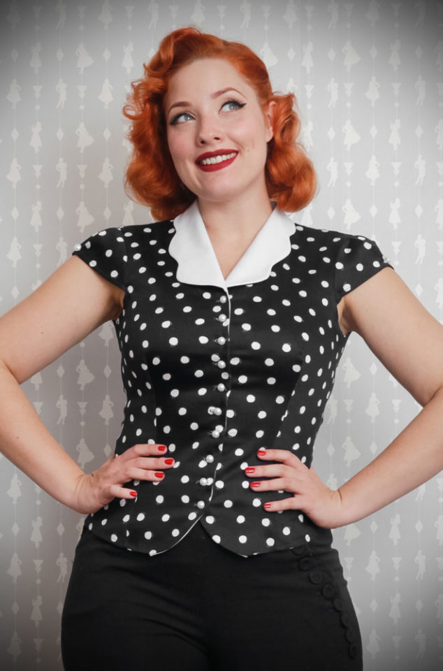 The Black Polka Salome Blouse is a sweet and effortless dotty blouse with a white scallop collar.www.DeadlyistheFemale.com are proud UK stockists of Miss Candyfloss.