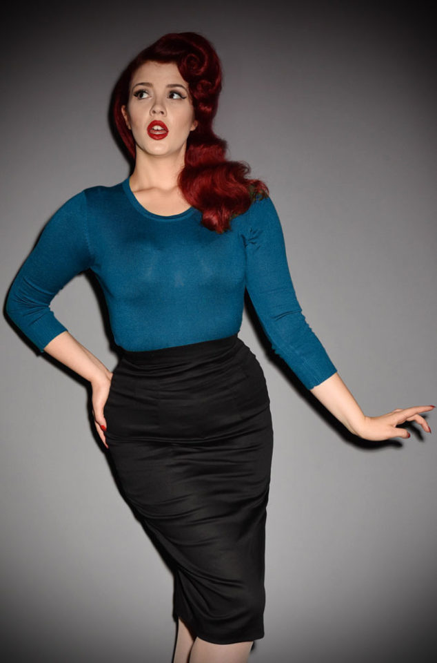 The50's style Teal Sweater Girl Sweater is perfect for pairing with your favourite retro separates.A vintage classic at Deadly is the Female