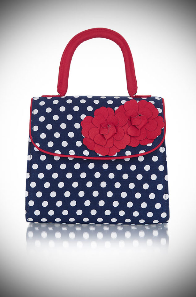 Introducing the Tortola bag. A navy and white polka dot handbag with lots of vintage inspired charm! Available now at DeadlyistheFemale.com