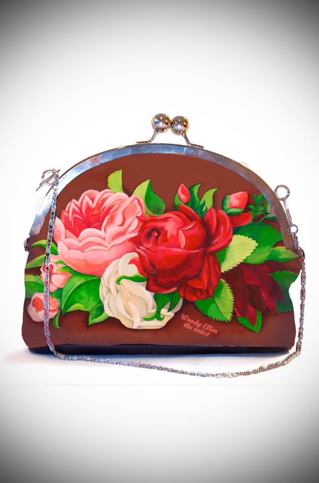 The Woody Ellen Clip Bag features romantic oversized roses on a rich but neutral background. Available now at UK stockists, Deadly is the Female