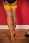 The Mustard Glamour Seamed Stockings are sheer nutmeg nylons with a yellow seam. They add a little bit of glamour to any outfit.