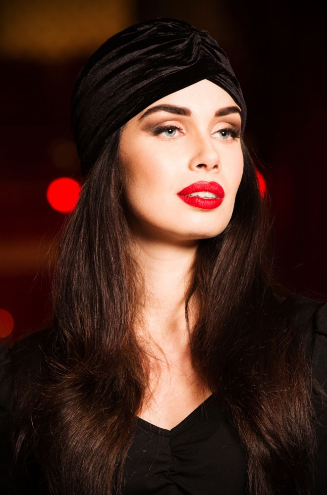 """Save a bad hair day and get instant vintage style? What's not to like about theBlack Velvet Turban! Featuring a gathered knot detail at the front, theBlack Velvet Turban is made from a stretch fabric. It is comfortable to wear and hides a multitude of hair """"sins""""!"""