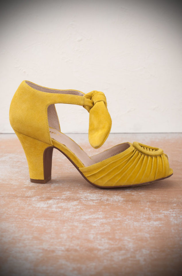 The yellow Miss L Fire Loretta shoes are beautiful vintage inspired heels. Made in stunning yellow suede these fantastic 1940's shoes have a charming feel. Available at Deadly is the Female - the perfect way to complete your pinup outfit.