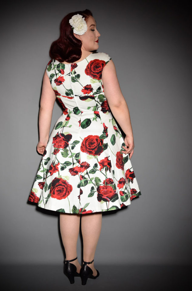 The Empire Dress in Victory Rose Print by Retrospec'd at UK stockists, Deadly is the Female. This 50s style rose print dress is a timeless classic. It is is oh-so romantic, with red roses on a fresh white background.